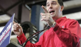 Wisconsin Gov. Scott Walker speaks at a campaign rally at Dane Manufacturing in Dane, Wis., Tuesday, April 15, 2014. Walker officially launched his re-election campaign Tuesday with a series of rallies across Wisconsin.  (AP Photo/Wisconsin State Journal, M.P. King)