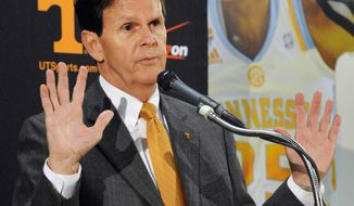 Tennessee athletic director Dave Hart announces Tennessee's Cuonzo Martin is leaving to be head coach at California during a news conference Tuesday, April 15, 2014, in Knoxville, Tenn. Hart said Martin's departure came as a surprise. (AP Photo/The Knoxville News Sentinel, Michael Patrick)