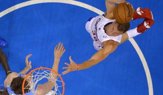 Los Angeles Clippers forward Blake Griffin, right, goes up for a dunk as Denver Nuggets forward Jan Vesely, of the Czech Republic, defends during the first half of an NBA basketball game, Tuesday, April 15, 2014, in Los Angeles.  (AP Photo/Mark J. Terrill)