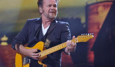 FILE - In this Sept. 21, 2013 file photo, John Mellencamp performs in Saratoga Springs, N.Y. Mellencamp, a liberal rocker, wants conservative Wisconsin Republican Gov. Scott Walker to know he supports union rights and says Walker should think about that before using his songs on the campaign trail.(AP Photo/Hans Pennink, File)