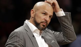 Brooklyn Nets' Jason Kidd scratches his head during the second half of the Nets' NBA basketball game against the New York Knicks on Tuesday, April 15, 2014, in New York. The Knicks won 109-98. (AP Photo/Frank Franklin II)