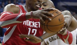 Houston Rockets center Dwight Howard (12) is fouled by New Orleans Pelicans center Melvin Ely (4) in the first half of an NBA basketball game in New Orleans, Wednesday, April 16, 2014. (AP Photo/Gerald Herbert)