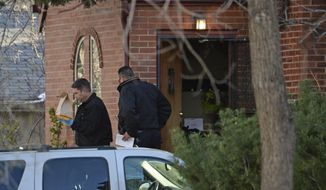 In this April 15, 2014 photo, authorities investigate a homicide in Denver. Richard Kirk is being held for investigation of first-degree murder in the death of his wife in their Denver home. Police are investigating whether marijuana played a role in the killing. Police officers arrived just after Kristine Kirk was shot in the head Monday, April 14, 2014, about 15 minutes after she called 911. (AP Photo/The Denver Post, RJ Sangosti) MAGS OUT; TV OUT; INTERNET OUT; NO SALES; NEW YORK POST OUT; NEW YORK DAILY NEWS OUT