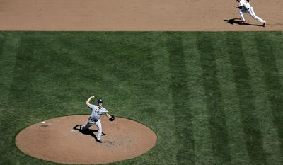Tampa Bay Rays relief pitcher Brad Boxberger, bottom left, throws to the Baltimore Orioles as Baltimore's Stephen Lombardozzi steals second base in the sixth inning of a baseball game, Wednesday, April 16, 2014, in Baltimore. Lombardozzi advanced to third on a throwing error by catcher Jose Molina. (AP Photo/Patrick Semansky)