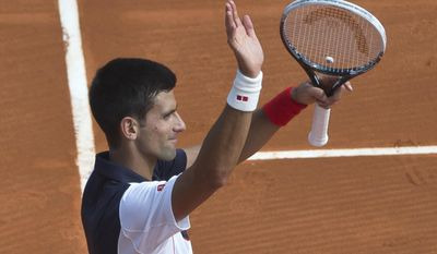 Novak Djokovic of Serbia acknowledges applause after defeating Albert Montanes of Spain in 6-1 6-0, during their match at the Monte Carlo Tennis Masters tournament in Monaco, Tuesday, April 15, 2014. (AP Photo/Michel Euler)