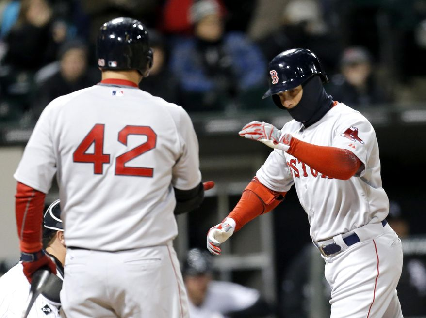 Boston Red Sox's Daniel Nava, right, is greeted at home by A.J. Pierzynski after Nava hit a home run off Chicago White Sox starting pitcher Erik Johnson during the fourth inning of a baseball game Tuesday, April 15, 2014, in Chicago. (AP Photo/Charles Rex Arbogast)