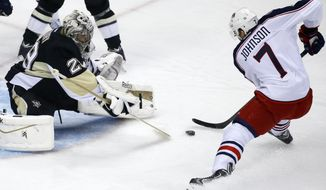 Columbus Blue Jackets' Jack Johnson (7) prepares to put the puck under the pads of Pittsburgh Penguins goalie Marc-Andre Fleury (29) for a goal during the first period of a first-round NHL playoff hockey game in Pittsburgh on Wednesday, April 16, 2014. (AP Photo/Gene J. Puskar)