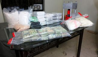 "William J. Bennett, the nation's first drug czar, is critical of the Obama administration -- especially the president -- for not using the ""bully pulpit"" of the White House to speak out against illegal drug use. A drug bust in New York City (pictured) netted more than $12 million in heroin and $500,000 in crystal methamphetamine. (AP Photo/Office of the Special Narcotics Prosecutor for the City of New York)"