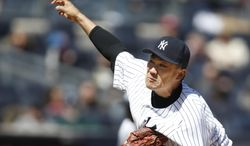New York Yankees starting pitcher Masahiro Tanaka delivers in the third  inning of Game 1 of an interleague baseball doubleheader against the Chicago Cubs at Yankee Stadium in New York, Wednesday, April 16, 2014.  (AP Photo/Kathy Willens)