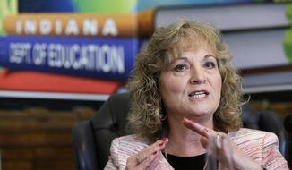 FILE - Glenda Ritz, Indiana Superintendent of Public Instruction, shown in this June 10, 2013 file photo, as she talks about interruptions experienced by students taking ISTEP tests. Indiana education leaders are rapidly approaching a deadline to approve new education standards to replace the national Common Core standards, which lawmakers and Gov. Mike Pence agreed to ditch. But infighting between state schools chief Glenda Ritz and the state Board of Education is putting new standards at risk. (AP Photo/Michael Conroy, File)