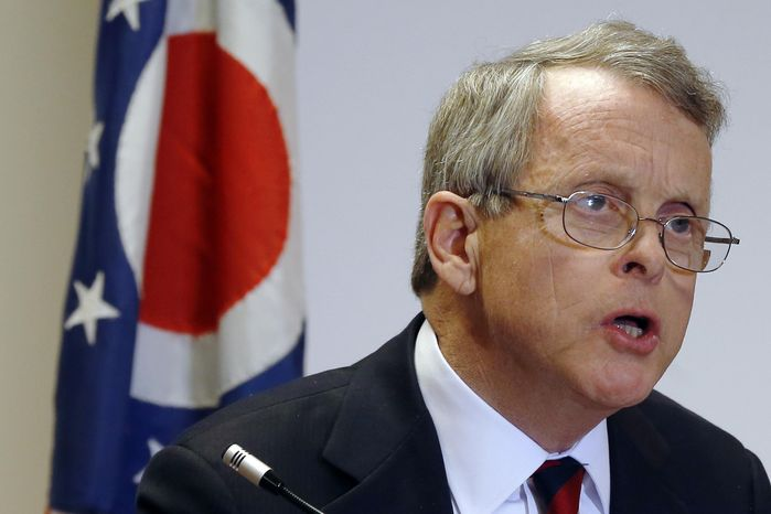 FILE - This Nov. 25, 2013 file photo shows Ohio Attorney General Mike DeWine speaking in Steubenville, Ohio. Negative campaigning and mudslinging may be a fact of life in American politics, but can false accusations made in the heat of an election be punished as a crime? That debate makes its way to the Supreme Court next week as the justices consider a challenge to a controversial Ohio law that bars false statements about political candidates during a campaign. DeWine, says he has serious concerns about th
