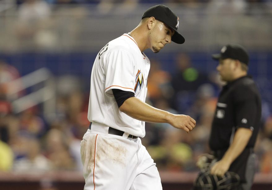 Miami Marlins starting pitcher Jose Fernandez walks to the dugout after pitching during the first inning of the MLB National League baseball game against the Washington Nationals, Wednesday, April 16, 2014, in Miami. (AP Photo/Lynne Sladky)