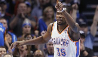 Oklahoma City Thunder forward Kevin Durant gestures following a basket in the first quarter of an NBA basketball game against the Detroit Pistons in Oklahoma City, Wednesday, April 16, 2014. (AP Photo/Sue Ogrocki)