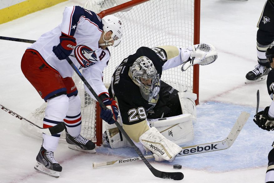 Columbus Blue Jackets' Brandon Dubinsky, left, can't get a shot past Pittsburgh Penguins goalie Marc-Andre Fleury (29) diuring the first period of a first-round NHL playoff hockey game in Pittsburgh on Wednesday, April 16, 2014.(AP Photo/Gene J. Puskar)