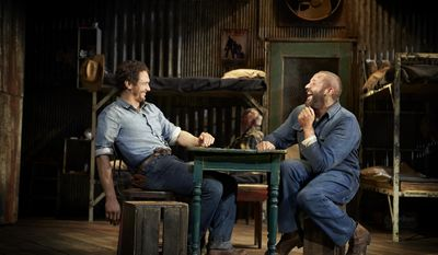 """This image released by Polk & Co. shows James Franco, left, and Chris O'Dowd in a scene from """"Of Mice and Men,"""" in New York. (AP Photo/Polk & Co., Richard Phibbs)"""