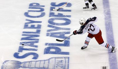 Columbus Blue Jackets' Ryan Murray (27) shoots during the first period of a first-round NHL playoff hockey game against the Pittsburgh Penguins in Pittsburgh on Wednesday, April 16, 2014.(AP Photo/Gene J. Puskar)