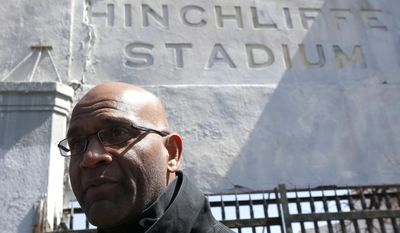 Larry Doby, Jr., the son of Larry Doby, a baseball player who integrated Major League Baseball's American League in July 1947, just months after Jackie Robinson broke the National League's color barrier, stands outside of Hinchliffe Stadium, Wednesday, April 16, 2014, in Paterson, N.J. Hinchliffe Stadium, where Doby Sr. played high school football before playing in the Negro League with the Newark Eagles, was once home to the New York Black Yankees, the New York Cubans and other Negro League baseball teams. Eleven members of the National Baseball Hall of Fame played there, including Larry Doby. The crumbling Art Deco stadium was granted national historic landmark status in 2013. Lawmakers are pushing to designate it as part of the nearby Great Falls National Historical Park. (AP Photo/Julio Cortez)