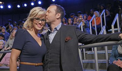 "This image released by ABC shows co-host Jenny McCarthy with her fiance Donnie Wahlberg after she announced her engagement on the daytime series ""The View,"" Wednesday, April 16, 2014 in New York. (AP Photo/ABC, Heidi Gutman)"