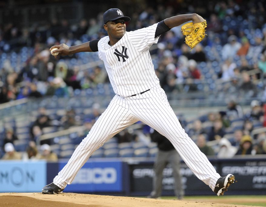 New York Yankees pitcher Michael Pineda delivers the ball to the Chicago Cubs during the first inning of Game 2 of an interleague baseball doubleheader on Wednesday, April 16, 2014, at Yankee Stadium in New York. (AP Photo/Bill Kostroun)