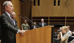 FILE - In this Aug. 19, 2013 file photo, then New York Mayor Michael Bloomberg, left, speaks at a news conference in New York where the announcement was made regarding the arrest of 19 people and seizure of 254 guns as part of gun smuggling between the Carolinas and New York. The former mayor, a billionaire and advocate of firearms regulation, plans to spend $50 million this year setting up a new group that will mix campaign contributions with field operations aimed at pulling gun-control supporters to the polls. The new organization, Everytown for Gun Safety, will focus on women, especially mothers, The New York Times reported on its website, Tuesday April 15, 2014. (AP Photo/Mark Lennihan, File)