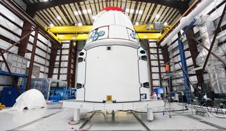 FILE - This Jan. 12, 2013 photo provided by NASA shows the SpaceX Dragon vehicle inside a processing hangar at Cape Canaveral Air Force Station in Cape Canaveral, Fla. SpaceX has scheduled another launch attempt Friday, April 18, 2014 to the International Space Station. NASA confirmed the launch date Wednesday, April 16, 2014, two days after a last-minute rocket leak delayed the delivery mission. Stormy weather, however, is forecast Friday. Saturday is the backup launch date. (AP Photo/NASA, Kim Shiflett)