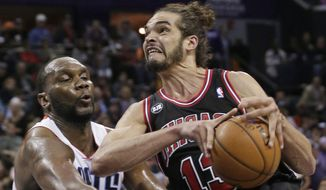 Charlotte Bobcats' Al Jefferson, left, strips the ball from Chicago Bulls' Joakim Noah during the second half of an NBA basketball game in Charlotte, N.C., Wednesday, April 16, 2014. The Bobcats won 91-86 in overtime. (AP Photo/Chuck Burton)