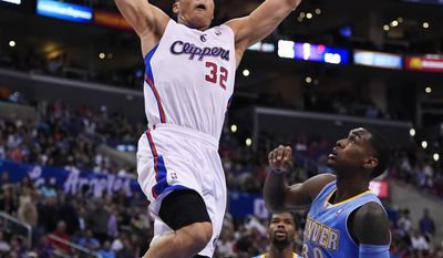 Los Angeles Clippers forward Blake Griffin, left, goes up for a dunk as Denver Nuggets forward Quincy Miller, right, defends and guard Aaron Brooks watches during the first half of an NBA basketball game, Tuesday, April 15, 2014, in Los Angeles. (AP Photo/Mark J. Terrill)