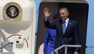 President Barack Obama, followed by Commerce Secretary Penny Pritzker, waves as they leaves Air Force One after arriving at the 171st Air Refueling Wing at the Pennsylvania Air National Guard base in Coraopolis, Pa., Wednesday, April 16, 2014. Obama joined Vice President Joe Biden in the Pittsburgh area to speak at a nearby community college about job training grants.  (AP Photo/Keith Srakocic)