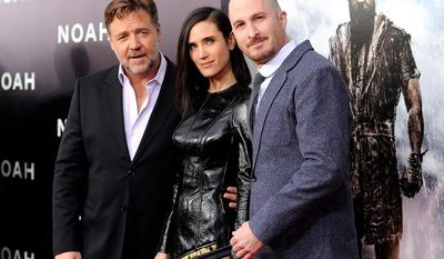 "Actors Russell Crowe, left, and Jennifer Connelly pose with director Darren Aronofsky at the premiere of ""Noah,"" at the Ziegfeld Theatre on Wednesday, March 26, 2014, in New York. (Photo by Evan Agostini/Invision/AP)"