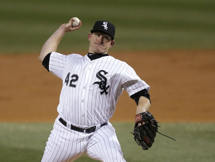 Chicago White Sox starting pitcher Erik Johnson delivers during the third inning of a baseball game against the Boston Red Sox on Tuesday, April 15, 2014, in Chicago. (AP Photo/Charles Rex Arbogast)