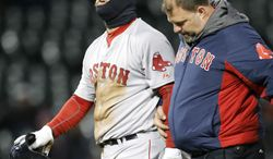 Boston Red Sox's Mike Napoli, left, walks off the field with trainer Rick Jameyson after badly bending his left ring finger into the bag while advancing on a wild pitch in the top of the ninth inning of a baseball game against the Chicago White Sox Tuesday, April 15, 2014, in Chicago. The White Sox won 2-1. (AP Photo/Charles Rex Arbogast)