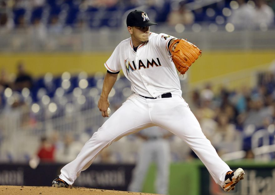 Miami Marlins starting pitcher Jose Fernandez throws during the first inning of the MLB National League baseball game against the Washington Nationals, Wednesday, April 16, 2014, in Miami. (AP Photo/Lynne Sladky)