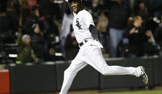 Chicago White Sox's Alexei Ramirez celebrates after scoring the game-winning run off a throwing error by Boston Red Sox shortstop Xander Bogaerts during the ninth inning of a baseball game Tuesday, April 15, 2014, in Chicago. Chicago won 2-1. (AP Photo/Charles Rex Arbogast)