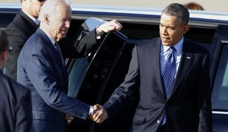 President Barack Obama, right, shakes hands with Vice President Joe Biden as Obama heads to Air Force One and Biden to Air Force Two as the two depart the 171st Air Refueling Wing at the Pennsylvania Air National Guard base in Coraopolis, Pa., on Wednesday, April 16, 2014. Obama and Biden were in the Pittsburgh area to speak at a nearby community college about job training grants. (AP Photo/Keith Srakocic)