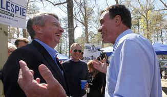 Republican senatorial candidate Ed Gillespie, left, and the man he hopes to unseat, Sen. Mark R. Warner, D-VA, right, meet during the 66th annual Shad Planking outside of Wakefield, Va., Wednesday, April 16, 2014. In the center is House of Delegates Clerk G. Paul Nardo. (AP Photo/Richmond Times-Dispatch, Bob Brown)