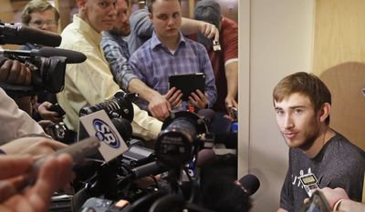 Utah Jazz's Gordon Hayward speaks to the media on the day the Jazz cleaned out their lockers after a 25-57 season, Thursday, April 17, 2014, in Salt Lake City. (AP Photo/Rick Bowmer)