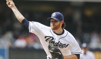 San Diego Padres starting pitcher Ian Kennedy works against the Colorado Rockies during the first inning of a baseball game Thursday, April 17, 2014, in San Diego.  (AP Photo/Lenny Ignelzi)