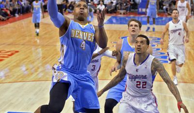 Denver Nuggets guard Randy Foye shoots as Los Angeles Clippers forward Matt Barnes defends during the first half of an NBA basketball game, Tuesday, April 15, 2014, in Los Angeles.  (AP Photo/Mark J. Terrill)
