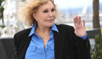 FILE - In this May 25, 2013 file photo, actress Kim Novak poses for photographers during the Homage to Kim Novak at the 66th international film festival, in Cannes, southern France. Novak said Thursday, April 17, 2014, that criticism of her appearance at the March 2 Oscars came as a surprise after her warm welcome at Cannes. (Photo by Joel Ryan/Invision/AP, file)