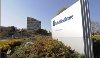 FILE - This Tuesday, Oct. 16, 2012, filephoto, shows a portion of The UnitedHealth Group Inc.'s  campus in Minnetonka, Minn. UnitedHealth Group's first-quarter net income slid 8 percent as fees and funding cuts from the health care overhaul helped dent the performance of the nation's largest health insurer the company announced Thursday April 17, 2014. (AP Photo/Jim Mone, File)
