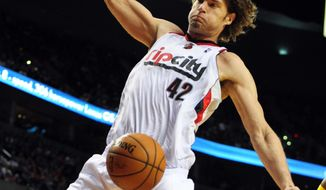 Portland Trail Blazers center Robin Lopez (42) dunks the ball during the second half of an NBA basketball game against the Golden State Warriors in Portland, Ore., Sunday, April 13, 2014. The Blazers won the game 119-117. (AP Photo/Steve Dykes)