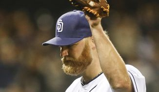 San Diego Padres starting pitcher Andrew Cashner acknowledges at the standing ovation from the fans as he leaves the game against the Colorado Rockies in the eighth inning of a baseball game Wednesday, April 16, 2014, in San Diego.  Cashner pitched seven and a third innings and allowed two runs while striking out five.   (AP Photo/Lenny Ignelzi)