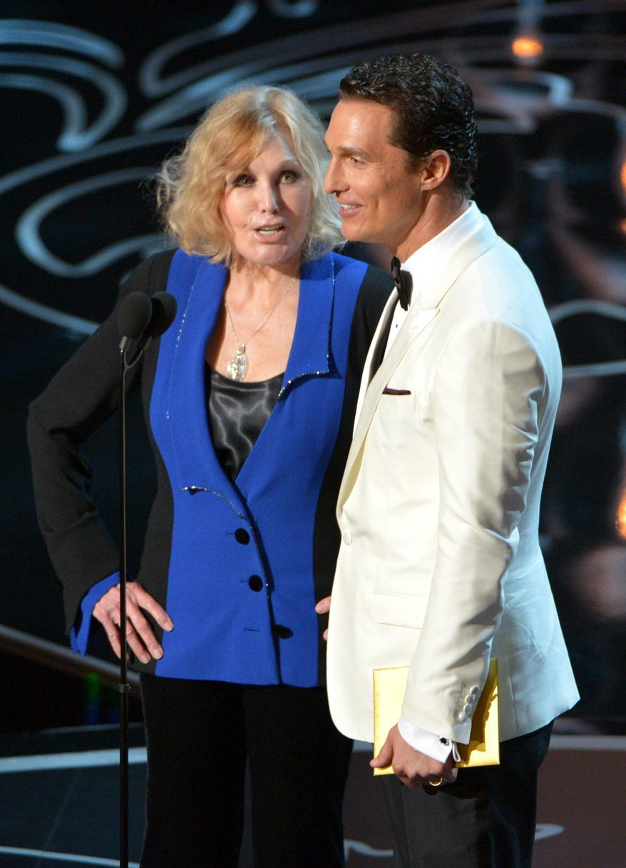 FILE - In this March 2, 2014 file photo, Kim Novak, left, and Matthew McConaughey speak during the Oscars at the Dolby Theatre in Los Angeles. Novak said Thursday, April 17, 2014, that criticism of how she looked as a presenter at the Oscars last month amounted to hurtful bullying, which she condemned in an open letter and interview.  (Photo by John Shearer/Invision/AP, file)