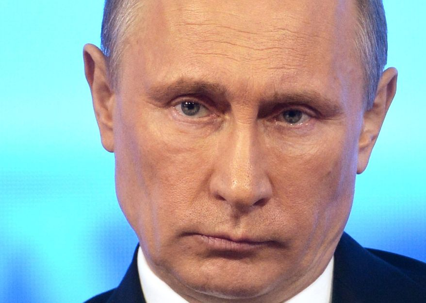 Russian President Vladimir Putin takes part in a televised call-in show with the nation in Moscow, Thursday, April 17, 2014. (AP Photo/RIA-Novosti, Alexei Nikolsky, Presidential Press Service)