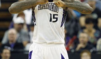 Sacramento Kings center DeMarcus Cousins tears at his jersey after drawing a technical foul against the Minnesota Timberwolves during the second half of an NBA basketball game in Sacramento, Calif., on Sunday, April 13, 2014. The Kings won 106-103.(AP Photo/Steve Yeater)