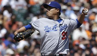 Los Angeles Dodgers pitcher Hyun-Jin Ryu (99), from South Korea, throws against the San Francisco Giants during the second inning of a baseball game in San Francisco, Thursday, April 17, 2014. (AP Photo/Jeff Chiu)