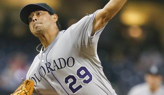 Colorado Rockies starting pitcher Jorge De La Rosa works against the San Diego Padres in the first inning of a baseball game Wednesday, April 16, 2014, in San Diego.  (AP Photo/Lenny Ignelzi)