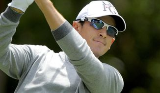Scott Langley hits off the ninth tee during the first round of the RBC Heritage golf tournament in Hilton Head Island, S.C., Thursday, April 17, 2014. (AP Photo/Stephen B. Morton)