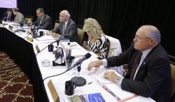 The Iowa Racing and Gaming Commission holds a hearing  in Council Bluffs, Iowa, Thursday, April 17, 2014. The commission decided to reject the proposed $164 million Cedar Rapids casino, saying a new casino would hurt existing ones. From left are: administrator Brian Ohrilko, commissioner Dolores Mertz, commissioner Jeff Lambert, commissioner Carl Heinrich, commissioner Kris Kramer and commissioner Rich Arnold. (AP Photo/Nati Harnik)