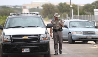** FILE ** Texas Department of Public Safety Trooper Shawn Baxter waits to advise the media at the Yearning for Zion Ranch, Thursday, April 17, 2014, near Eldorado, Texas. State agents have seized the property, which belonged to the Fundamentalist Church of Jesus Christ of Latter Day Saints, and was where hundreds of children were removed during a 2008 FBI raid prompted by child sex abuse allegations.  (AP Photo/San Angelo Standard-Times, Jennifer Rios)